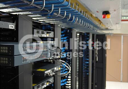 Communication racks in a datacenter filled with switches and routers that keep all the servers connected.