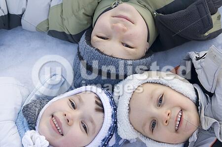 three children on snow