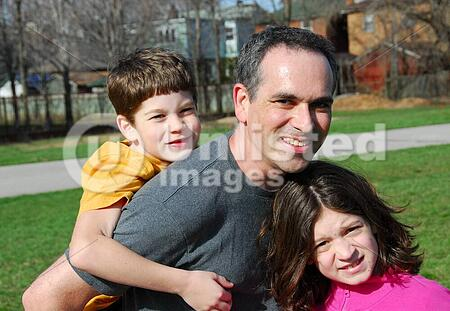 Father with children playing outside