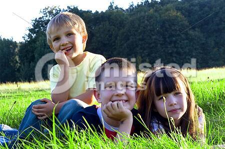 Happy children in green grass
