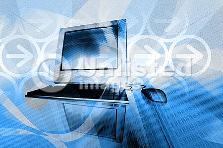 desktop computer with abstract design elements in warm background
