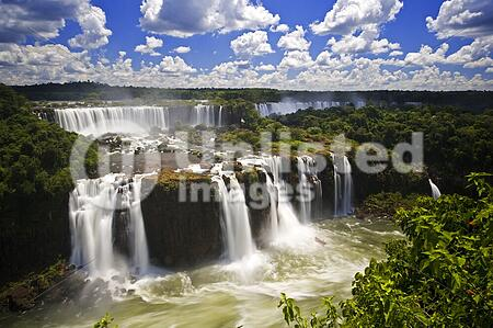 Iguassu Falls is the largest series of waterfalls on the planet, located in Brazil, Argentina, and Paraguay. At some times during the year one can see as many as 275 separate waterfalls cascading along the edges of 2, 700 meters (1. 6 miles) cliffs. Argenti