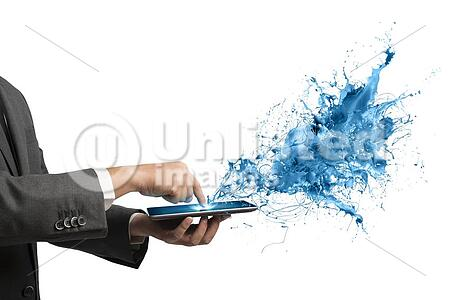 Concept of creative technology with businessman and tablet