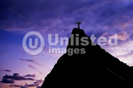 Christ the Redeemer on Corcovado Mountain, Rio de Janeiro Brazil South America The statue stands 38 m (125 feet) tall and is located at the peak of the 710-m (2330-foot) Corcovado mountain in the Tijuca Forest National Park, overlooking the city. As well