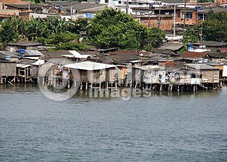 poor houses built out over the water in brazi