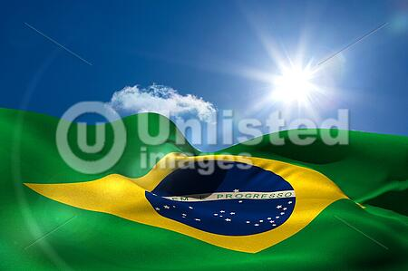 Digitally generated brazil national flag under sunny sky