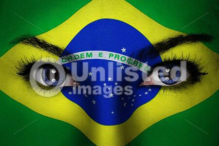 Woman with Brazil flag painted on her face