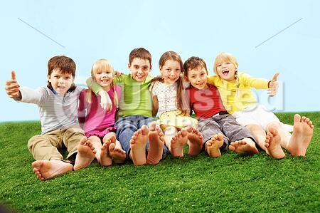 Cheerful children having fun on grass