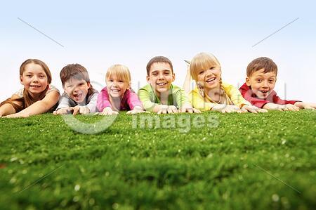 CHildren having rest on lawn