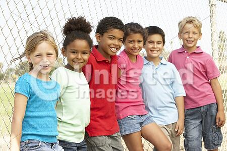 Group Of Children Playing In Park