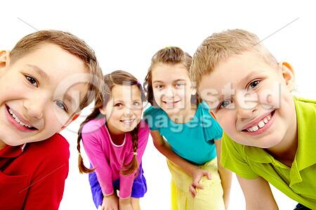 Group of joyful children peeping into camera