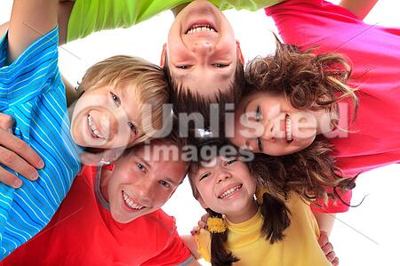 Happy smiling faces of a group of children.