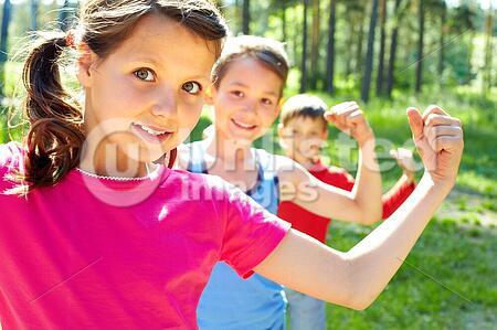 Three little children posing at camera