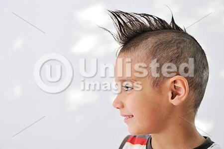 Cute Little Boy With Funny Hair And Cheerful Grimace Latinstock