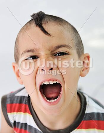 Cute Little Boy With Funny Hair And Cheerful Grimace Stock Photos
