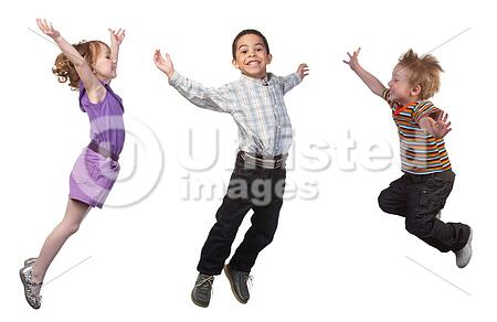 Happy and smiling children jumping, over white