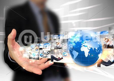 Businessman holding world. Technology concept