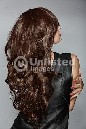 Woman With Long Brown Curly Hair Latinstock