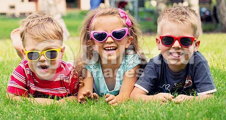 Funny picture of three playing children