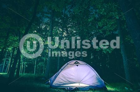 Camping Tent In Dark Forest