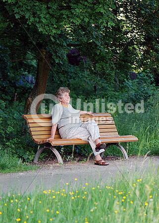 Pensioner Sitting In Park
